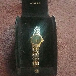 GOLD/SILVER WOMANS MOVADO WATCH